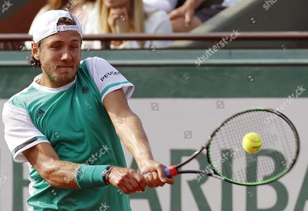 Lucas Pouille of France in action against Thomaz Bellucci of Brazil during their men?s single 2nd round match during the French Open tennis tournament at Roland Garros in Paris, France, 31 May 2017.