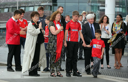 Stock Image of Julie Morgan (C) with Lorraine Barrett (L) surrounded by relatives after the service