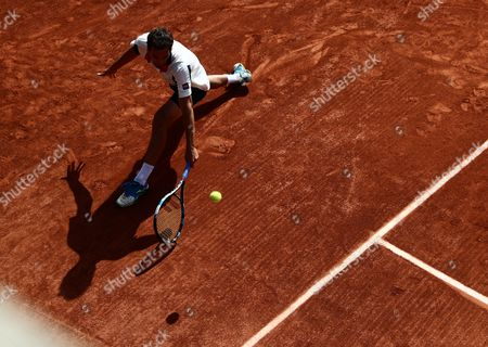 Stock Photo of Albert Ramos-Vinolas of Spain in action against Benjamin Bonzi of France during their men?s single 2nd round match during the French Open tennis tournament at Roland Garros in Paris, France, 31 May 2017.