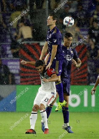 Lamar Neagle, Jonathan Spector, Luis Gil Orlando City's Jonathan Spector, center, and Luis Gil, right, go over the head of D.C. United's Lamar Neagle (13) to gain possession of the ball during the first half of an MLS soccer game, in Orlando, Fla