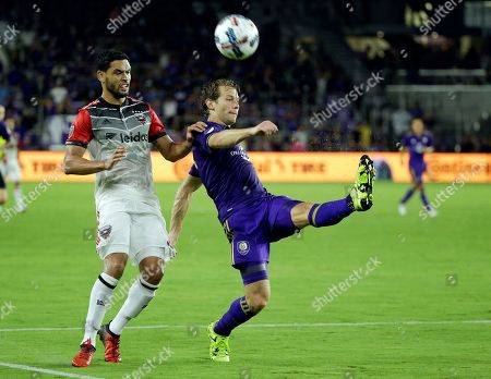 Marcelo Sarvas, Jonathan Spector Orlando City's Jonathan Spector, right, clears the ball from the goal area in front of D.C. United's Marcelo Sarvas during the second half of an MLS soccer match, in Orlando, Fla. Orlando won 2-0