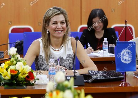 Queen Maxima of the Netherlands smiles during a meeting with Vietnamese Finance Minister Dinh Tien Dung in Hanoi, Vietnam, . The Dutch Queen is in Vietnam for a three-day visit in her role as the U.N. Secretary General's Special Advocate for Inclusive Finance for Development to discuss with Vietnamese leaders and senior officials on access to financial services