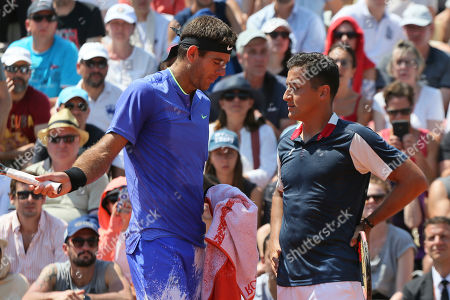 Argentina's Juan Martin del Potro, left, and Spain's Nicolas Almagro talk during their second round match of the French Open tennis tournament at the Roland Garros stadium, in Paris, France