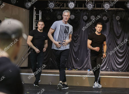 Choreographer Ashley Bango rehearsing with Elliot Wright, Mark Foster and Harry Judd for the Real Full Monty at the Shiregreen Club in Sheffield.