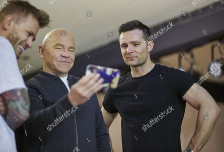 Matt Wolfenden Dominic Littlewood and Harry Judd watch a recording of their performance on Doms phone for the Real Full Monty at the Shiregreen Club in Sheffield.