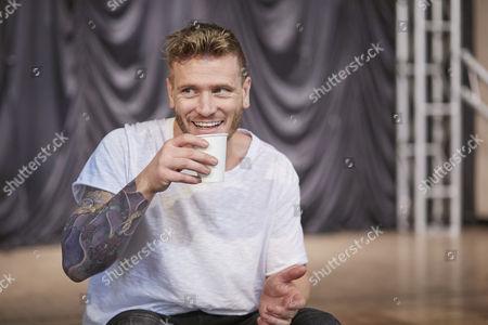 Stock Photo of Matt Wolfenden takes a break during rehearsals