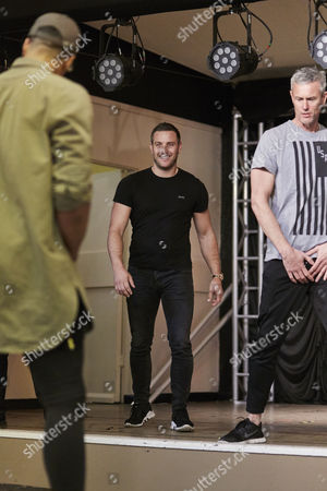 Choreographer Ashley Bango directs Elliot Wright and Mark Foster during the rehearsal for the Real Full Monty at the Shiregreen Club in Sheffield.