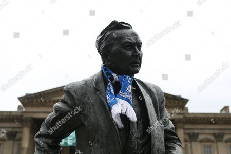 The statue of Harold Wilson in St Georges Square is adorned with Huddersfield Town scarf