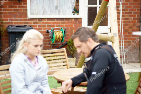 Sarah Platt, as played by Tina O'Brien, is pleased and when Neil Clifton, as played by Ben Cartwright, arrives at the house Sarah is happy to let him have some time with Bethany Platt, as played by Lucy Fallon, and watches through the window relieved Bethany is speaking to the police - unaware of what is really being discussed. (Ep 9180 - Mon 5 Jun 2017)