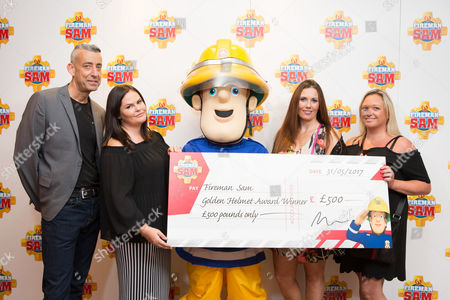 Stock Photo of The character Fireman Sam with 'Team Freddie' from Yately in Hampshire(Marc Whitman, Debbie King, Emma Fullard and Bonnie Slade) receiving their award for 'Inspiration to Others' at the Soho Hotel, London