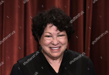 Associate Justice Judge Sonia Sotomayor poses for a group photograph at the Supreme Court building in Washington, DC.
