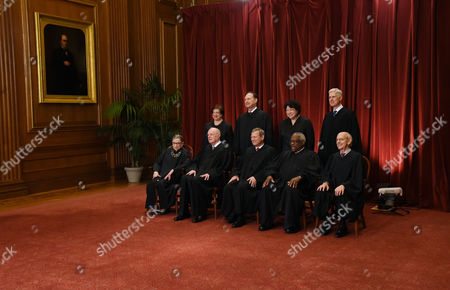Members of the US Supreme Court pose for a group photograph at the Supreme Court building in Washington, DC. Front row. Seated from left, Associate Justice Ruth Bader Ginsburg, Associate Justice Anthony M. Kennedy, Chief Justice of the United States John G Roberts Jnr, Associate Justice Clarence Thomas, and Associate Justice Stephen Breyer and Standing behind from left, Associate Justice Elena Kagan, Associate Justice Samuel Alito Jr., Associate Justice Judge Sonia Sotomayor, and Associate Justice Neil Gorsuch.
