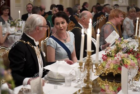 From left, King Carl Gustaf of Sweden, Mrs Jenni Haukio, wife of Finnish President, King Harald V of Norway, former Finnish President Tarja Halonen at the table