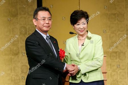Stock Picture of Governor Yuriko Koike (R) shakes hands with New Komeito Party lawmaker Yosuke Takagi (L)