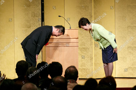 Stock Photo of Tokyo Governor Yuriko Koike (R) and New Komeito Party lawmaker Yosuke Takagi (L) greet each other