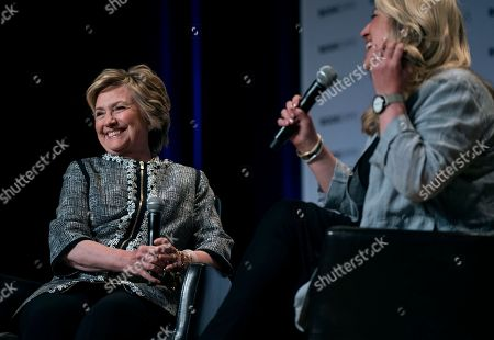 Hillary Clinton listens to author and moderator Cheryl Strayed during the Book Expo event in New York