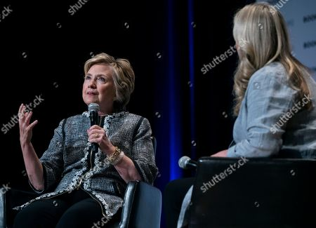 Former Secretary of State Hillary Clinton speaks alongside moderator and author Cheryl Strayed during the Book Expo event in New York