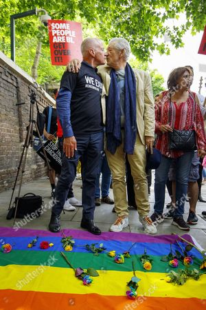 Michael Cashman and Sir Ian McKellen lay flowers to protest outside the Russian Embassy in London, calling on the Russian authorities to fully investigate reports of a crackdown and torture on LGBTI people in Chechnya.