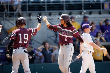 Texas Southern's Jose Camacho (6) is greeted by Jeremy Thomas (19) after Camacho scored a run in the first inning of a game against LSU at the LSU Regional of the NCAA college baseball tournament in Baton Rouge, La