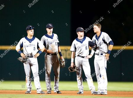 Stock Photo of ORU middle infielders Cal Hernandez #5, Dylan Snypes #12, Nick Roark #6 and Brent Williams #17 come together during a pitching change. The Arkansas Razorbacks defeated the Oral Roberts Golden Eagles 3-0 at Baum Stadium in Fayetteville, AR, Richey Miller/CSM