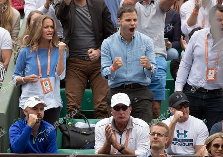 Andy Murray's player's box, including Kim Sears, wife of Andy Murray, Head Coach Ivan Lendl and Jamie Delgado celebrate Andy Murray winning match point as he defeats Juan-Martin del-Potro in his third round match