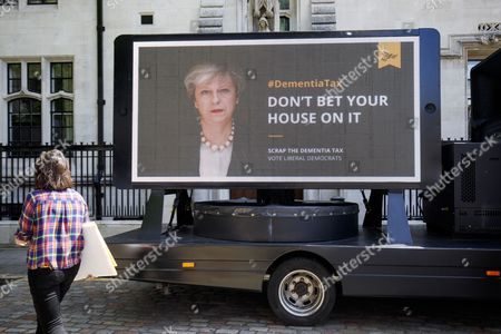 """Simon Hughes, Liberal Democrat candidate and former Southwark & Old Bermondsey MP reveals a new poster of Theresa May accompanied by the words: """"Don't bet your house on it"""" to criticise the so called """"dementia tax"""""""