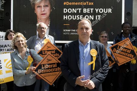Stock Picture of Liberal Democrat parliamentary candidate Simon Hughes joins supporters at the unveiling of their latest campaign poster about Conservative Party's social care policies, in London, Britain, 03 June 2017. British Prime Minister Theresa May has called a general election for 08 June 2017.