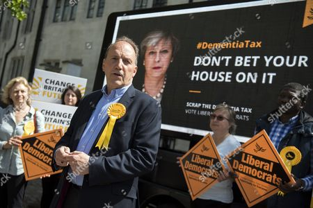 Stock Photo of Liberal Democrat parliamentary candidate Simon Hughes joins supporters at the unveiling of their latest campaign poster about Conservative Party's social care policies, in London, Britain, 03 June 2017. British Prime Minister Theresa May has called a general election for 08 June 2017.