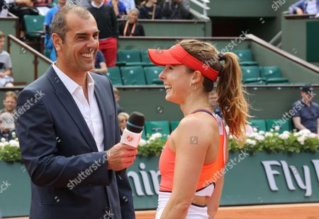 Stock Photo of French tennis player Alize Cornet is answering questions of Cedric Pioline