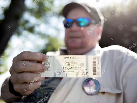 Mark Elliott shows a concert ticket from the last Gregg Allman concert he attended, in Macon, Ga. Family, friends and fans on Saturday will say goodbye to the music legend, who died over the Memorial Day weekend at the age of 69