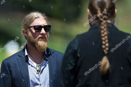 Derek Trucks, left, arrives for the funeral of Gregg Allman, in Macon, Ga. Family, friends and fans gathered to say goodbye to music legend Gregg Allman, who died over the Memorial Day weekend at the age of 69