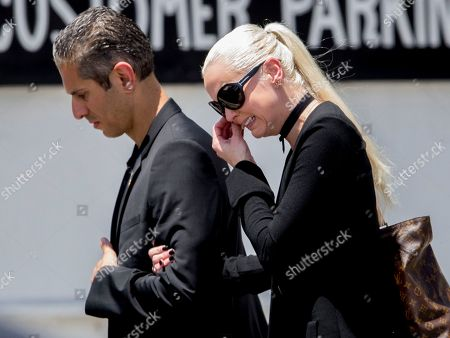 Delilah Island, right, gets emotional as she arrives for the funeral of her father, Gregg Allman, in Macon, Ga. Family, friends and fans gathered to say goodbye to music legend Gregg Allman, who died over the Memorial Day weekend at the age of 69