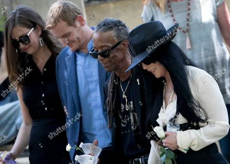 Cher, right, walks with friends and family following the burial of Gregg Allman, in Macon, Ga. Family, friends and fans gathered to say goodbye to music legend Gregg Allman, who died over the Memorial Day weekend at the age of 69