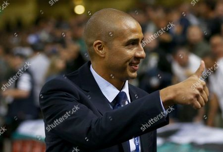 Former Juventus forward David Trezeguet gestures to supporters before the Champions League final soccer match between Juventus and Real Madrid at the Millennium stadium in Cardiff, Wales