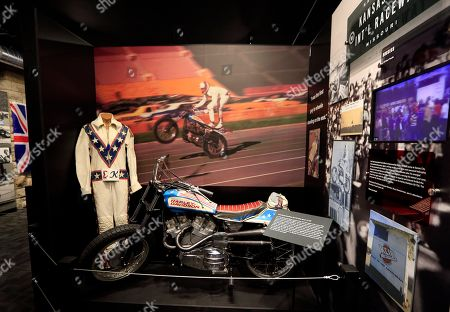 The cycle and leathers used by Evel Knievel at his Kansas City International Speedway jump are on display at the Evel Knievel Museum in Topeka, Kan., . A new Kansas museum is giving enthusiasts of late motorcycle daredevil Evel Knievel a jump on appreciating his death-defying, bone-breaking exploits. The $5-million, 13,000-square-foot homage to the man famous for rocket-powered and motorbike stunts before his 2007 death has opened in Topeka