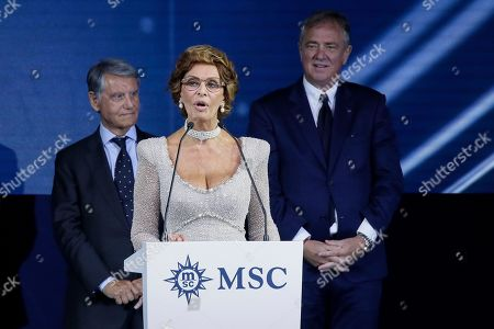 Stock Picture of Italian actress Sofia Loren, center, delivers a speech with MSC Group Executive Chairman Gianluigi Aponte, left, and Executive Chairman of MSC Cruises Pierfrancesco Vago, right, during the christening ceremony of the MSC Meraviglia cruise ship in the Havre harbour, Normandy, France, . The cruise ship is the biggest built by MSC Cruises, the Swiss-based world's largest privately-owned cruise line and also the biggest ship to come into service in 2017