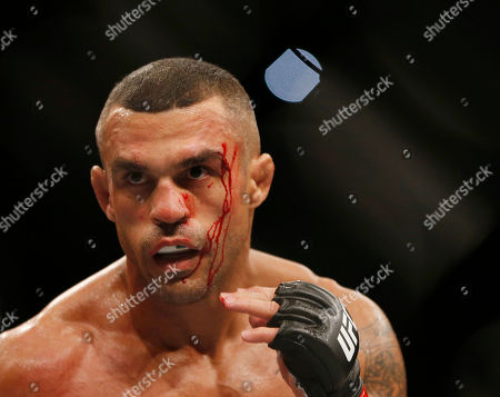 Vitor Belfort, Nate Marquardt Vitor Belfort, of Brazil, has blood trickling down his face during a UFC middleweight mixed martial arts bout against Nate Marquardt, of the United States, in Rio de Janeiro, Brazil