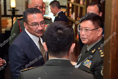 He Lei, Hishammuddin Tun Hussein Malaysian Minister of Defense Hishammuddin Hussein, left, speaks to Chinese Lt. Gen. He Lei, right, vice president of Academy of Military Science, through an interpreter at the 16th International Institute for Strategic Studies Shangri-la Dialogue, or IISS, Asia Security Summit in Singapore