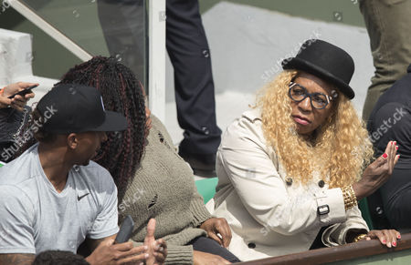 Oracene Price, mother of Venus Williams, reacts during play between Venus Williams and Timea Bacsinszky of Switzerland in the round of 16