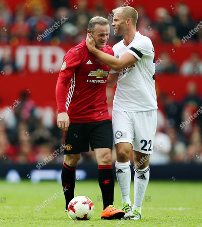 Stock Image of Wayne Rooney of Man Utd 08 XI and Eidur Gudjohnsen of Michael Carrick All Star XI