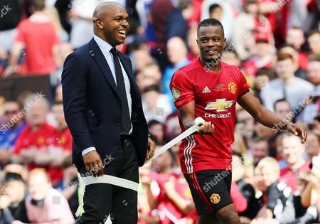 Patrice Evra of Man Utd 08 XI wraps Quinton Fortune in bandage tape at the end of the game