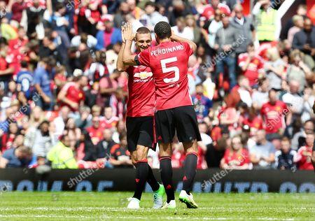 Nemanja Vidic of Man Utd 08 XI celebrates scoring his goal to make it 1-1 with Rio Ferdinand