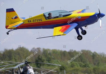 Sevenfold world champion in aerobatics Svetlana Kapanina pilots her Extra 300L plane during an air show marking 75th anniversary of 6th airforce army based in north-west region of Russia in St. Petersburg, Russia