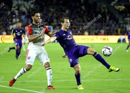 Marcelo Sarvas, Jonathan Spector Orlando City's Jonathan Spector, right, clears the ball from the goal area in front of D.C. United's Marcelo Sarvas during the second half of an MLS soccer game, in Orlando, Fla. Orlando Won 2-0