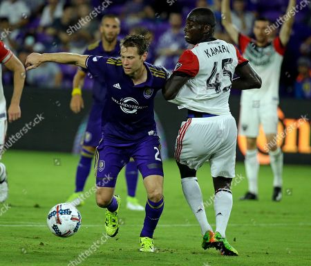 Orlando City's Jonathan Spector (2) moves the ball past D.C. United's Alhaji Kamara (45) during the second half of an MLS soccer game, in Orlando, Fla. Orlando Won 2-0