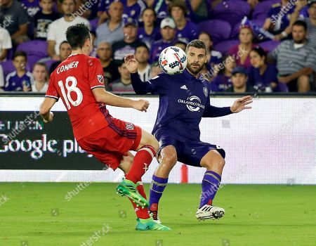 Drew Conner, Antonio Nocerino Chicago Fire's Drew Conner (18) and Orlando City's Antonio Nocerino, right, battle for possession of the ball during the first half of an MLS soccer game, in Orlando, Fla