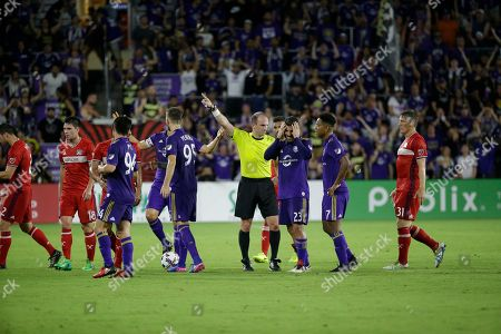 Antonio Nocerino, Ted Unkel Orlando City's Antonio Nocerino (23) reacts after Referee Ted Unckel, left, gave him a red card ejecting him from the game during the second half of an MLS soccer game, in Orlando, Fla. The game ended in a 0-0 draw