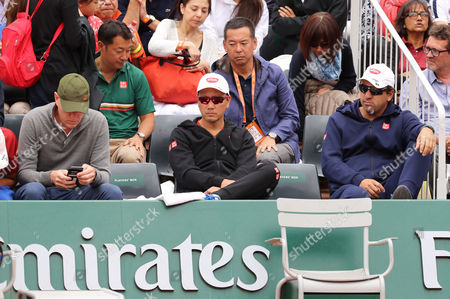 Coach Michael Chang is watching Japanese tennis player Kei Nishikori in action during his 3rd round match at the ATP French Open in Roland Garros Stadium vs Korean tennis player Hyeon Chung on Jun 3, 2017 in Paris, France.