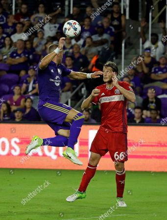 Orlando City's Jonathan Spector, left, heads the ball away from Chicago Fire's Joao Meira (66) during the second half of an MLS soccer game, in Orlando, Fla. The game ended in a 0-0 draw