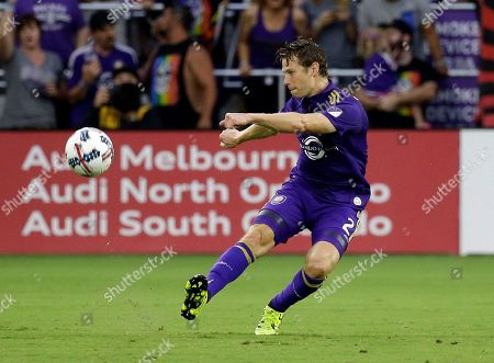 Orlando City's Jonathan Spector moves the ball against the Chicago Fire during the first half of an MLS soccer game, in Orlando, Fla